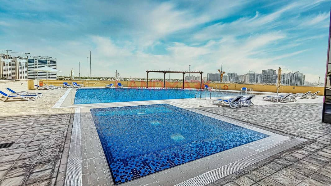 Modern 1BR | Luxury tower | Balcony | City View | Covered Parking