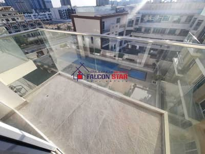 Studio for Sale in Jumeirah Village Circle (JVC), Dubai - LUXURIOUS FURNISHED POOL VIEW STUDIO   WITH HIGH ROI  9%