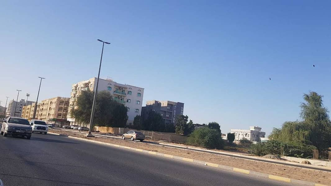 prime locaiton 13455 sq ft commercial land 3 sides road 2 sides corner on main road near royal furniture in mowhiyat 3