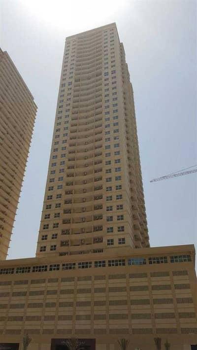 فلیٹ 2 غرفة نوم للبيع في مدينة الإمارات، عجمان - شقة في برج الزنبق مدينة الإمارات 2 غرف 260000 درهم - 4869841