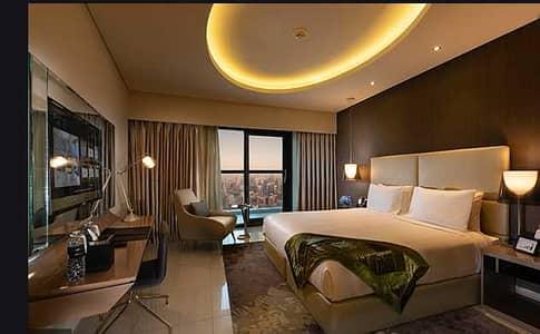شقة فندقية 2 غرفة نوم للبيع في الخليج التجاري، دبي - شقة فندقية في أبراج داماك من باراماونت للفنادق والمنتجعات الخليج التجاري 2 غرف 2250000 درهم - 4729718