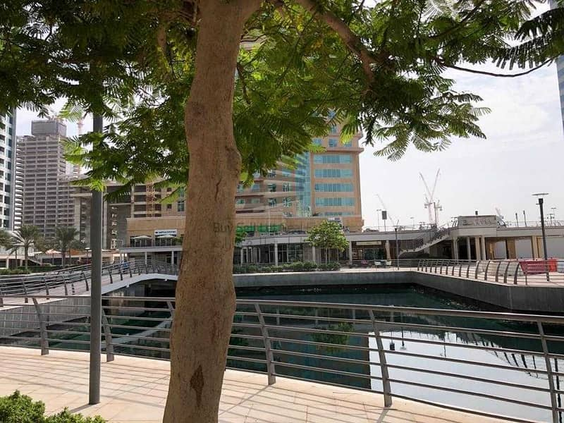 BIG & SPACIOUS SHELL & CORE SHOP FOR RENT WITH CANAL & GARDEN VIEW /CENTRALLY LOCATED IN NEW DUBAI GATE 2 JLT