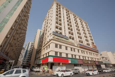 شقة 1 غرفة نوم للايجار في منطقة الرولة، الشارقة - Spacious 1BHK With Balcony + One Month FREE Available In Rolla