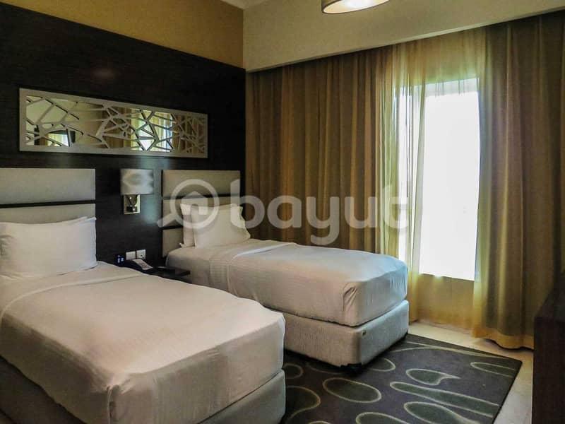 شقة في فندق غايا جراند مدينة دبي للإنتاج 2 غرف 130000 درهم - 4698949