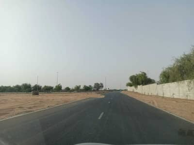 Plot for Sale in Al Zahia, Ajman - Residential land for sale, excellent location, in installments, freehold for all nationalities, no registration fees