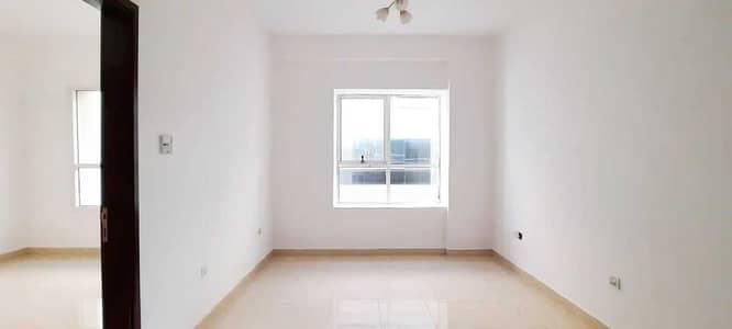 فلیٹ 1 غرفة نوم للايجار في جاردن سيتي، عجمان - شقة في أبراج اللوز جاردن سيتي 1 غرف 13000 درهم - 4829705