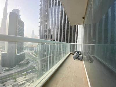 شقة 2 غرفة نوم للايجار في وسط مدينة دبي، دبي - فسيحة 2 BR إغلاق المطبخ أسفل المدينة