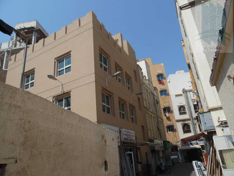 2 Commercial Building in prime location in Al Dhaghaya