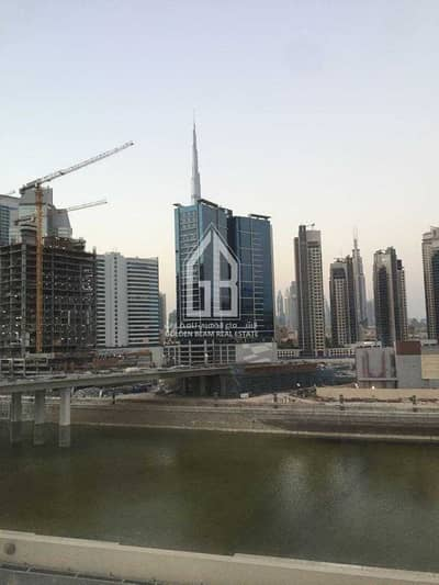 1 Bedroom Flat for Rent in Business Bay, Dubai - BUSINESS BAY   CANAL VIEW - UNFURNISHED 1BHK APARTMENT   FOR SALE   AED 700000