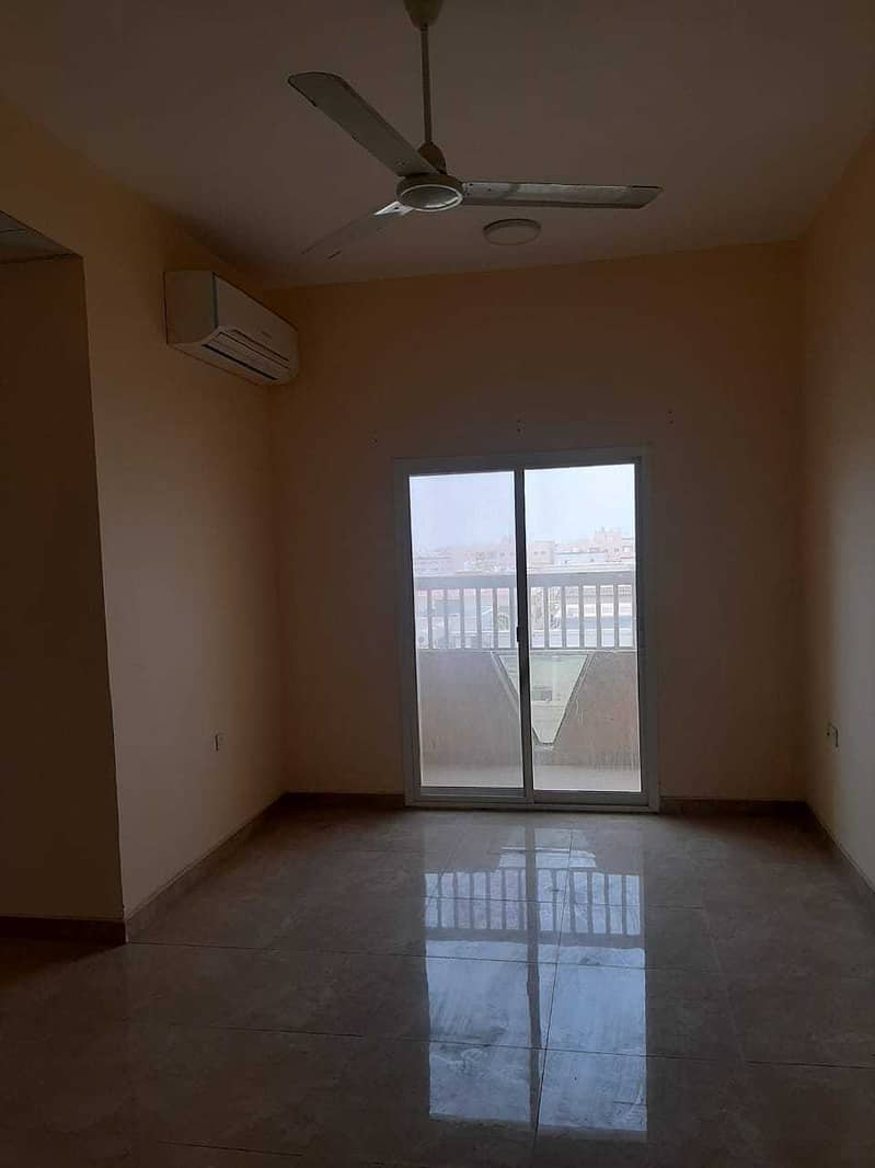 For rent in Ajman, a two-room apartment and a hall in Al-Rawda on Sheikh Ammar Street, with 2 balcony, very large areas. Payment facilities are up to 6 payments.