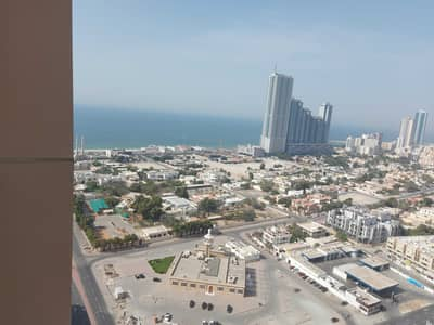 2 Bedroom Apartment for Sale in Al Sawan, Ajman - FOR SALE :EMPTY 2BHK +STORE+LAUNDRY SEA &FULLY OPEN VIEW IN AJMAN ONE TOWERS AJMAN ONE