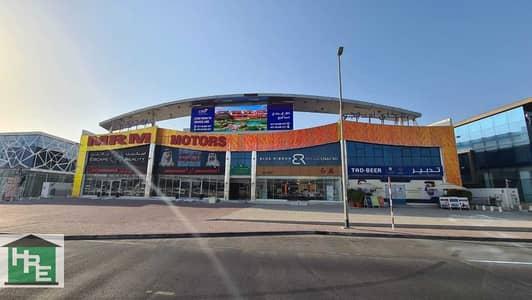 معرض تجاري  للايجار في أم الشيف، دبي - Fitted Showroom | Sheikh Zayed Road Facing
