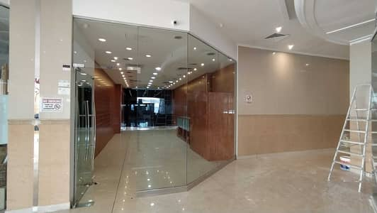 Shop for Rent in Al Rumaila, Ajman - Spacious 550 Sq. Ft Retail / Office Space Available with Free Central A/C | Al Shorafa Tower 1 | Rumaila 3 | AJMAN