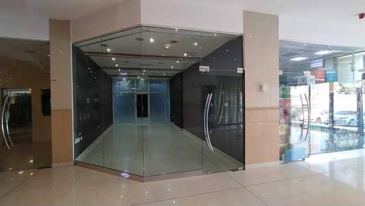 Shop for Rent in Al Rumaila, Ajman - EXCLUSIVE OFFER!! 450 Sq. Ft SHOP AVAILABLE AL SHORAFA TOWER 1, RUMAILA 3, AJMAN.