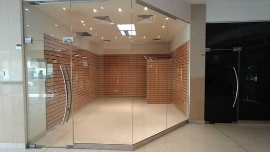 Shop for Rent in Al Rumaila, Ajman - Rent a Shop in a Prime Location! Free Central A/C!  Available in AL Shorafa Tower 1, Al Rumaila 3, Ajman.