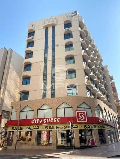 Shop for Rent in Bur Dubai, Dubai - Retail Space with Basement Store & Mazanian Floor   6 Chqs
