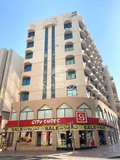 Shop for Rent in Bur Dubai, Dubai - Spacious Shop + Mezzanine Floor  Bath & Pantry  6 Chqs