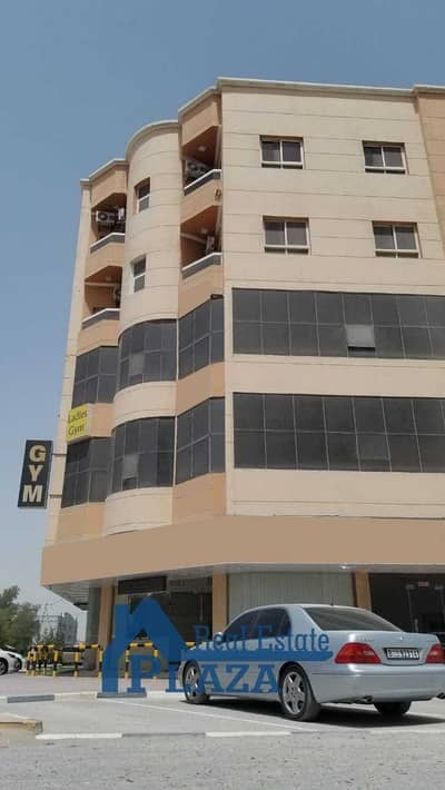 Floor for Rent in Al Rawda, Ajman - Commercial Space Building Outside View