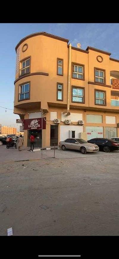 مبنی تجاري  للبيع في الروضة، عجمان - بنايه للبيع بسعر لقطة زاويه شارعين سكني تجاري 10%