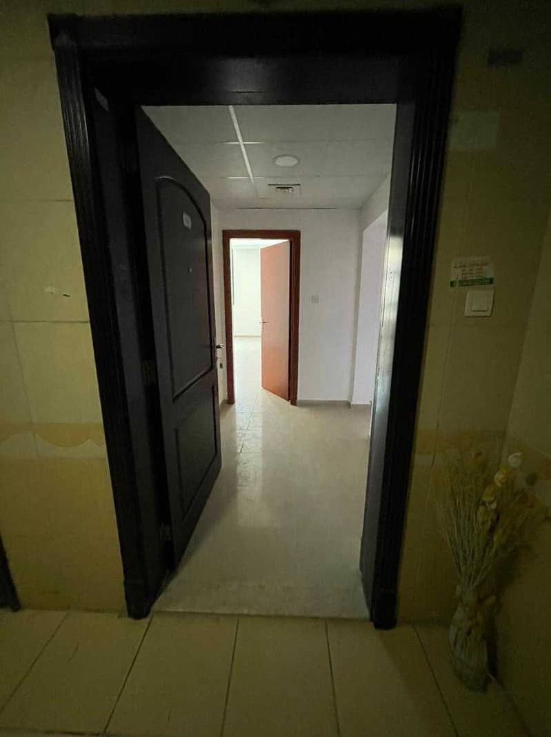 For rent a very large apartment with an area of 1566 feet in Al Rashidiya Towers, two rooms and a hall with 2 bathrooms, in a very privileged location and close to all services such as Nesto Hypermarket and Ajman Society Markets, and also near Ajman Cor