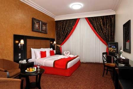 فلیٹ 1 غرفة نوم للايجار في النهدة، الشارقة - شقة في فندق رويال جراند النهدة 1 غرف 55000 درهم - 4569201