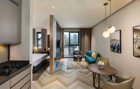 شقة فندقية  للايجار في برشا هايتس (تيكوم)، دبي - Premium Studio Hotel Apartment