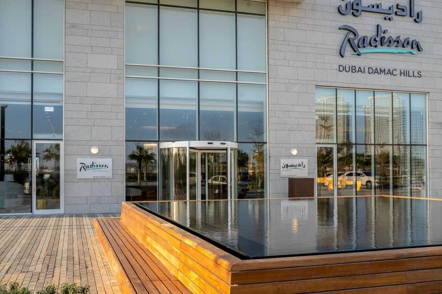 شقة فندقية في فندق راديسون دبي في داماك هيلز داماك هيلز (أكويا من داماك) 6499 درهم - 5188331