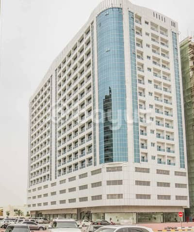 Shop for Rent in Al Jurf, Ajman - Shops for rent overlooking Sheikh Ammar Street - inside a large residential building 200 units - new building - two months free - without commission