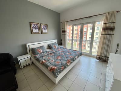 Studio for Rent in Discovery Gardens, Dubai - BED AND BALCONY