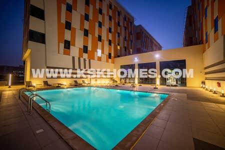 مجمع سكني  للايجار في المدينة الأكاديمية، دبي - Swimming Pool