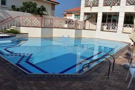5 Bedroom Villa for Rent in Jumeirah, Dubai - Near The Beach   Stunning 5 Bed Villa   Shared Pool & Gym !