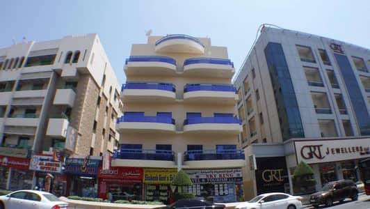 Studio for Rent in Al Karama, Dubai - 1 BHK Flat in Al Karama w. 13 months Contract