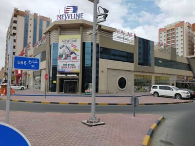 Showroom for Sale in Al Nuaimiya, Ajman - Showroom for sale in Ajman, Al Ittihad Street, a very privileged location on three streets