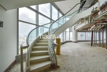 شقة 6 غرف نوم للبيع في مركز دبي التجاري العالمي، دبي - Two Connecting Duplexes  Shell and Core  Burj View