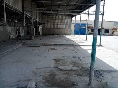 ارض صناعية  للايجار في المنطقة الصناعية، الشارقة - Open plot with warehouse