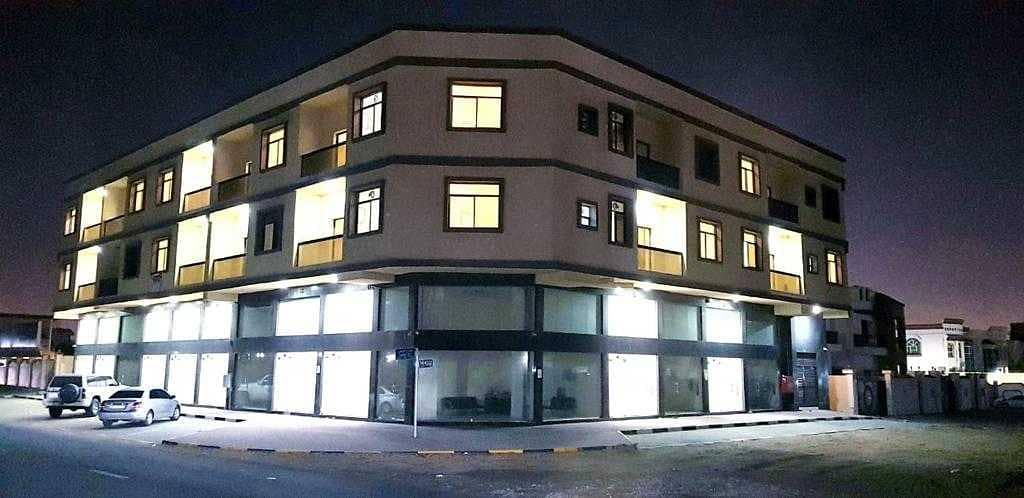 13500 SQ FT CORNER BUILDING WTH 14 SHOPS ON GOOD LOCATION IN AL RAWDHA 2