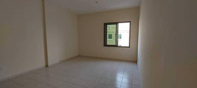 فلیٹ 1 غرفة نوم للايجار في المدينة العالمية، دبي - شقة في الحي الروسي المدينة العالمية 1 غرف 25000 درهم - 4464007