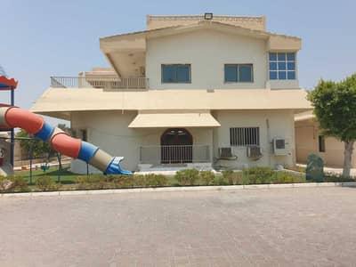 فیلا 6 غرف نوم للايجار في دسمان، الشارقة - فیلا في دسمان 6 غرف 100000 درهم - 5294164