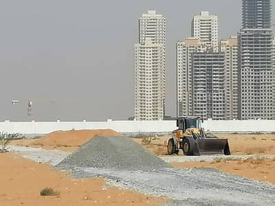 Plot for Sale in Al Amerah, Ajman - Land for sale in Al Amerah area, Ajman, residential and investment, the land next to Al Watan University and Fam Holding ** Smart Tower ** a minute aw