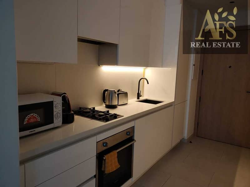 2 Spacious  1 Month Free  Fully Furnished   Marquise Square Tower  Chiller & Gas Included