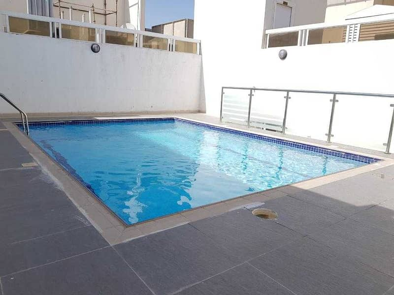 Hot offer 1bhk with one month free  , balcony, wardrobe  ,gym ,pool , kids play area ,ledies sperate  gym ,rent only 19,993 al taawun area