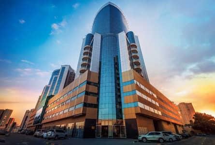 Studio for Rent in Al Bustan, Ajman - Spacious Studio In Orient Towers Balcony + Parking 14k