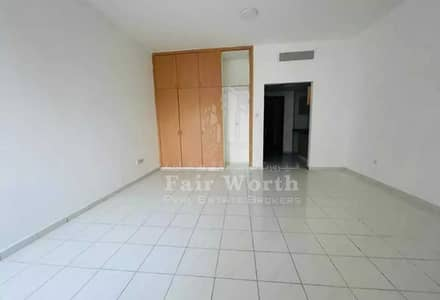 Studio for Rent in International City, Dubai - Studio | Italy Cluster | With Balcony | Family Building | Close to Major Amenities