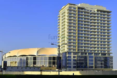 Office for Rent in Dubai Sports City, Dubai - Bright Office with Cricket stadium view.
