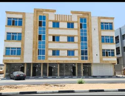 مجمع سكني  للبيع في الروضة، عجمان - بناية سكنى تجارى على شارع الشيخ عمار مباشرة تملك حر تشطيبات سوبر ديلوكس