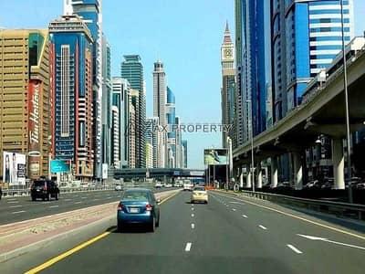 ارض استخدام متعدد  للبيع في شارع الشيخ زايد، دبي - ارض استخدام متعدد في شارع الشيخ زايد 130000000 درهم - 5310523