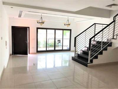 4 Bedroom Villa for Sale in Jumeirah Village Circle (JVC), Dubai - 4 BR Maids Townhouse |Front yard | 2 Covered parkings