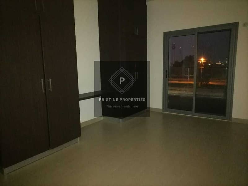 2 Balcony with community View  2 Bed Room and Maid room For Rent at Al Rawdah