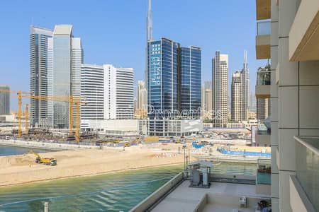 1 Bedroom Apartment for Sale in Business Bay, Dubai - Corner unit Full bay view Partial burj view