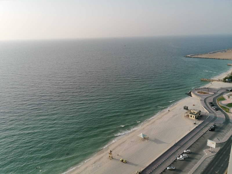 MINDBLOWING OFFER 2BHK FULL SEA VIEW OPEN KITCHEN BIG SIZE AVAILABLE FOR RENT CORNICHE RESIDENCE TOWERS AJMAN